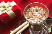 stock photo of hot-chocolate  - hot chocolate in a glass mug with cookies and a christmas gift - JPG