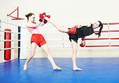picture of muay thai  - muai thai women fighting at training boxing ring - JPG