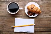 picture of croissant  - Cup of coffee with fresh croissant and blank sheet of paper on wooden table - JPG
