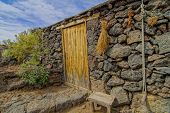 foto of stone house  - Exterior of Abandoned Stone Made Houses In a Medieval Village El Hierro Island Spain - JPG