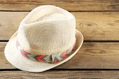 stock photo of panama hat  - Beach hat on wooden background - JPG