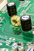 picture of capacitor  - macro of black capacitors from circuit board  - JPG