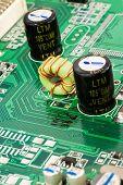 pic of capacitor  - macro of black capacitors from circuit board  - JPG