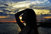 pic of humility  - summer beautiful girl at sunset on the sea - JPG