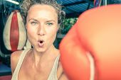Woman Hitting With Punch On Gritty Determination - Fitness Boxe And Mixed Martial Arts Concept poster