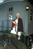picture of caboose  - retired nurse stands on the steps of a caboose - JPG