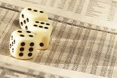 picture of stock market data  - newspaper with german stock market and dice - JPG