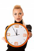 Постер, плакат: Worried Woman With Big Orange Clock Gesturing Delay Rush Nervous Stress Because Of Lack Of Time