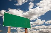 stock photo of road sign  - Blank Green Road Sign on Dramatic Blue Sky with Clouds  - JPG