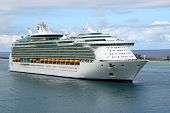 pic of cruise ship caribbean  - Cruise ship pulling into the harbor during the day - JPG