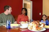 stock photo of biscuits gravy  - Family having thanksgiving dinner - JPG