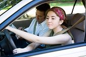 Teen driver taking driving lessons from professional instructor.