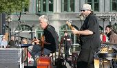 NEW YORK - JULY 1: Bassist Marty Ballou (Center-R) performs with blues singer John Hammond (L) and k