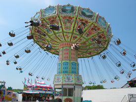 foto of carnival ride  - a swinger ride at a carnival on a beautiful day - JPG