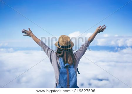 poster of Young Woman Traveler With Sky Blue Backpack And Hat Looking The Map With Tuk Tuk Thailand Background