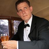 Man In Tux With Drink