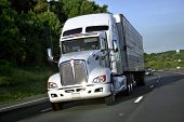 picture of semi-truck  - Big truck of load in movement on highway - JPG