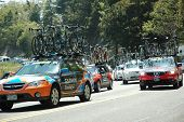 RUNNING SPRINGS, CA - MAY 21: Support vehicles for the Amgen Tour of California follow Stage 6 on Ma