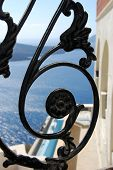 picture of wrought iron  - Detail of a wrought iron gate with the caldera in the background - JPG