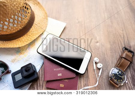 poster of Passport With A Map On Wooden Background.travel Planning.top View Of Traveler Accessories With A Hat