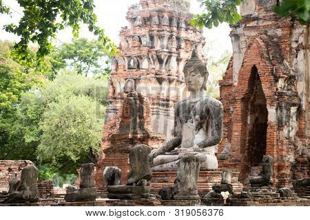 poster of Ruins of Buddha statues and pagoda in Wat Mahathat, the old Thai temple inside Ayutthaya historical