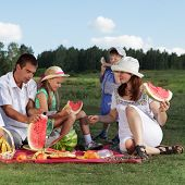 foto of family fun  - families picnic outdoors with food - JPG