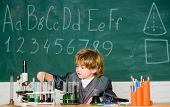 Little Boy At Chemical Cabinet. Experimenting With Chemicals Kid In Lab Coat Learning Chemistry Litt poster