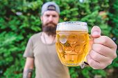 Creative Young Brewer. Distinct Beer Culture. Hipster Brutal Bearded Man Hold Mug Cold Fresh Beer. M poster