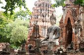 Ruins of Buddha statues and pagoda in Wat Mahathat, the old Thai temple inside Ayutthaya historical  poster