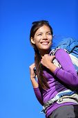 Hiker portrait. Woman hiking outdoors smiling happy and aspirational. Beautiful young mixed race Cau