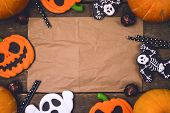 Delicious Ginger Biscuits Cookies And Ripe Pumpkins For Halloween On Wooden Background Halloween Bac poster