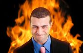 Furious businessman engulfed in flames