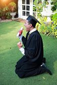Happy Man Graduated Holding And Showing Degree, Idea For Education Concept poster