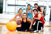 stock photo of gym workout  - group of people at the gym smiling - JPG