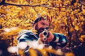 Hunter Man Hunting. Hunting Period, Autumn Season. Male With A Gun. A Hunter With A Hunting Gun And  poster