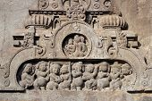 picture of ellora  - Religious carving around the entrance to a Buddhist cave temple at Ellora Caves in India - JPG