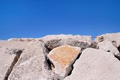 White Rocks And Stones With Blue Sea And Sky In The Landscape Background. Beautiful White Rock Stone poster