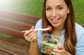 Young Woman Eating Salad On Lunch Break In City Park Living Healthy Lifestyle. Happy Smiling Brazili poster