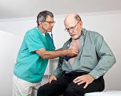 Doctor Or Nurse Listens To Older Patient's Heart And Lungs