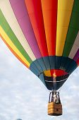 Beautiful Colorful Hot Air Balloon Flying In The Tranquil Sky - Ten poster