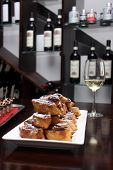 Delicious fried date pastries and a glass of white wine
