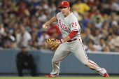 LOS ANGELES - AUG 31: Phillies 2B (26) Chase Utley fields a ground ball and throws to second during