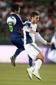 CARSON, CA. - APRIL 30: Chivas USA midfielder Francisco Mendoza #6 (L) & New England Revolution midf