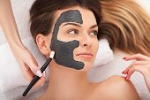 Hardware Cosmetology. Closeup Picture Of Lovely Young Woman With Cream Mask In A Beauty Parlour. poster