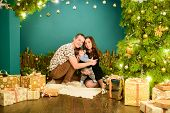 Young Family Celebrates New Year. The First Christmas Of A Newborn With A Baby. Young Family Celebra poster