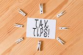Conceptual Hand Writing Showing Tax Tips. Business Photo Text Compulsory Contribution To State Reven poster