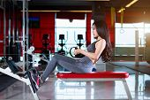 Fitness Asian Women Performing Doing Exercises Training With Rowing Machine (seat Cable Rows Machine poster