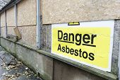 Asbestos Danger Sign At Building Construction Site Refurbishment Of Old Building poster