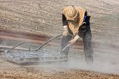 stock photo of sandblasting  - Sandblasting of metal structures at construction site - JPG