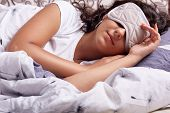 Image Of Young Woman Sleeping With Eye Mask, Lying Under Cosy Blanket In Comfortable Bed At Home, Br poster